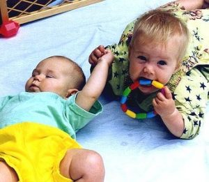 charlotte and friend in playpen